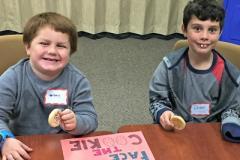 Two boys eating cookies