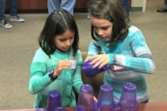 Two girls stacking cups